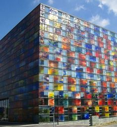 The Institute for Sound and Vision, Hilversum, The Netherlands, has cube-shaped building featuring an exterior of cast-glass panes.