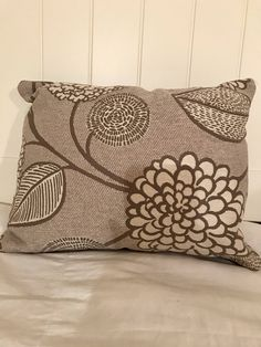 A personal favorite from my Etsy shop https://www.etsy.com/listing/567137893/beige-floral-throw-pillow