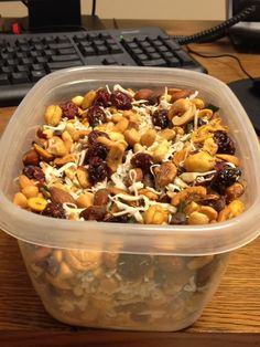 Super cheap and easy homemade trail-mix! Shaved coconut, almonds, sweet and salty cashews, dried cranberries, chocolate and butterscotch chips. I'd maybe add peanuts too.