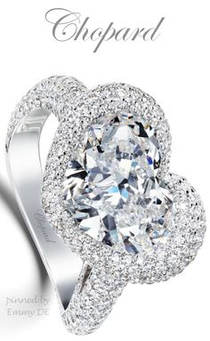 Emmy DE * platinum and heart-shaped diamond engagement ring by Chopard