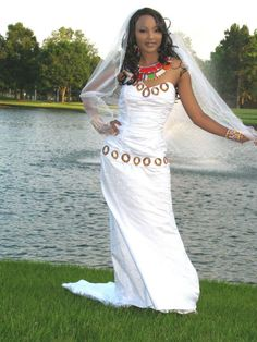 Kenyan wedding dress by TeKay Designs worn with Maasai necklaces, bracelets and earrings Kenyan Wedding, Ethnic Wedding, Bridal Gowns, Wedding Gowns, Girls Dresses, Flower Girl Dresses, Pregnant Wedding, Bridal And Formal, Boutique