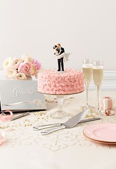 Shop all of our reception accessories, including serving tools, cake toppers, and napkins! #davidsbridal #weddingcakes #reception