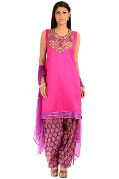 Grab this fuchsia toned suit now to spread your charm like never before! The rich yet soothing embroidery has been done on its yoke which gives it an elegant look. The amalgamation of purple and golden creates a lasting look for its wearer! On its hemline, velvet laces have been attached with uber grace! Get it now to spread your charm around!