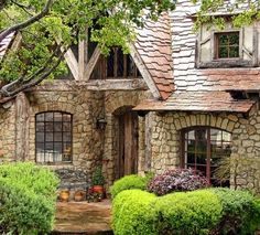 Love the front entry on this old world style cottage home. | http://homechanneltv.blogspot.com/2014/07/charming-cottages.html #cottage #home #oldworld #stone #exterior