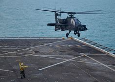 Aviation Boatswain's Mate (Handling) 3rd Class Hannah Marihugh launches an AH-64D Longbow Apache helicopter assigned to 3-159 Attack Reconnaissance Battalion off the flight deck of the amphibious transport dock ship USS New York (LPD 21). (U.S. Navy photo by Mass Communication Specialist 2nd Class Zane Ecklund/Released)