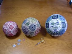 The Quaker Ball in all three sizes. The pattern used is the same on each ball but they look quite different done in different counts, fabric and threads.