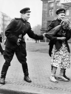 The spoils of victory. Russian soldiers sexually harass a German woman in Leipzig, Germany, August Historians estimate that Soviet soldiers raped up to 2 million German women during the Red Army's invasion and military occupation of German territory German Women, German Girls, Man Of War, Maria Callas, Army Soldier, Red Army, Soviet Union, Soviet Army, Women In History