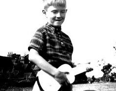 eric clapton with his first instrument, a ukulele