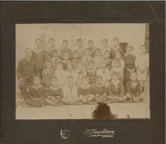 "A photo of a school class. Signed: ""Ch.Tsirivakos"". Greece, twentieth century. Courtesy Peloponnesian Folklore Foundation, all rights reserved."