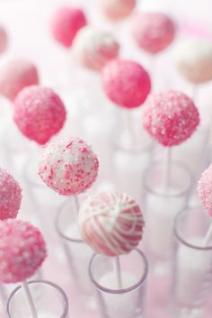 Pink Cake Pops - displayed in glasses filled with sugar. I have this new obsession with cake pops and if they're pink it makes them even better. Oreo Cake Pops, Pink Cake Pops, Baby Shower Sweets, Baby Shower Cake Pops, Party Desserts, Mini Desserts, Dessert Party, Pink Snacks, Cake Pop Displays