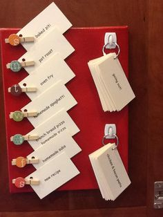 menu board made with business size cards, rings, hooks, and little clothespins.  I love this idea!