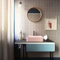 Offset the vertical focus of subway tiles with a black-and-white vanity and sherbet pink basin #HGInspiration