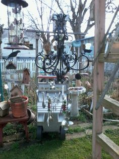 I reused this old chandelier mixing beaters and misc silverware and made my mom a windchime.
