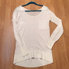 """VS Moto Sweater From VS Essentials Sweater Line off white Moto sweater. Lightweight 100% cotton has ribbed sleeves, elbow patches and 1 pocket on left chest. Bust 24"""" across length in front 27"""" back 30"""". Very good condition. No tag I removed it. Happy Poshing  Victoria's Secret Sweaters Crew & Scoop Necks"""