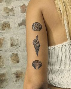 seashell tattoo by lucas lua de souza