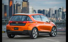 General Motors kicked off the Detroit auto show Monday, not with a bang, but with the hum of an all-electric concept car—and a lot of ensuing buzz. Electric Bolt, Electric Car Concept, Electric Cars, Electric Vehicle, Chevy, Chevrolet Volt, Chevrolet Silverado, General Motors, Bmw I3