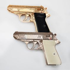 """Walther Pistols in Gold and Silver- Our GOTD(s) give you the best of both gold and silver and the best part is that the engraving just came along for the ride!  Actually both of these Walther PPK/s pistols are factory engraved and are part of the """"Artistry in Arms"""" collection begun by Dr. William L. and Collette M. Roberts."""