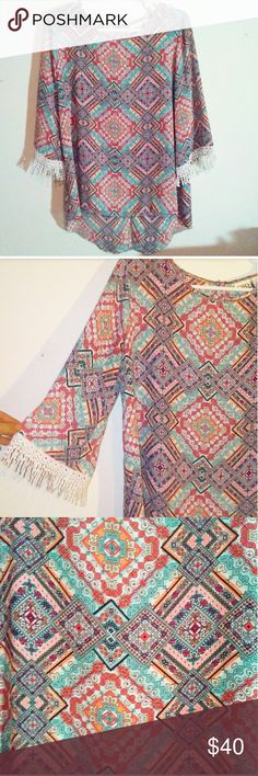 """· NWOT Boho Tunic · Brand New Condition!!  Features a scoop, high-low hem with a cute slit in back measuring approximately 8"""".  3/4 Bell Sleeves with embroidered lace crochet design wuth fringes.   SUPER FEMINE & BOHO!  Size tag says medium but its an oversized fit. Bust is approximately 40""""-41"""" Length in front is 25"""" Lebgth in back is 29""""-30""""  100% Polyester  The colors are absolutely gorgeous! PERFECT SPRING TUNIC! Tops Tunics"""
