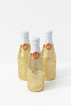 DIY Party Ideas: How to make Glittered Mini Party Drink Bottles  Super cute and easy for New Year's Eve and any party.