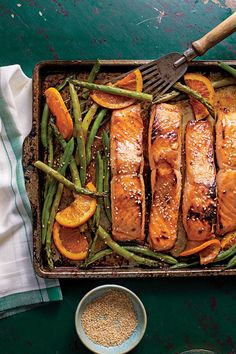 Honey-Soy-Glazed Salmon with Veggies and Oranges - Simple Sheet Pan Suppers - Southernliving. Recipe: Honey-Soy-Glazed Salmon with Veggies and Oranges
