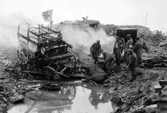 At Kemmel, West Flanders, Belgium. The effect of enemy artillery fire upon German ambulances, in May of 1918. #  National Archive / Official German Photograph of WWI