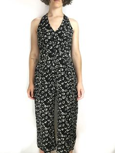 Black and white floral printed jumpsuit, poly blend. Shop prettypennyclothing.com