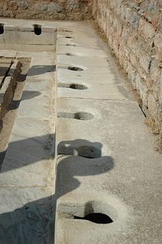 Ancient Roman Toilets - Now I am just imagining a bunch of men pooping while having some kind of meeting. Lol