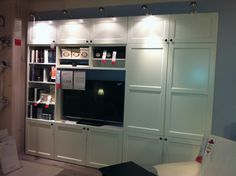 TV ON RIGHT BEHIND DOORS, FP WHERE TV IS? LIKE THE LIGHTING. Ikea Besta entertainment unit $1310