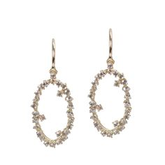 White sapphires glitter in oval 14K yellow gold starburst settings in these feminine drop earrings from Kalan14K http://www.fragments.com/starburst-oval-drop-earrings-kalan-14k.html?___store=default