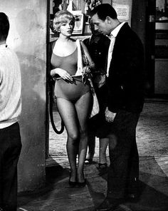 """Marilyn Monroe and Yves Montand on the set of Let's Make Love, 1960. """