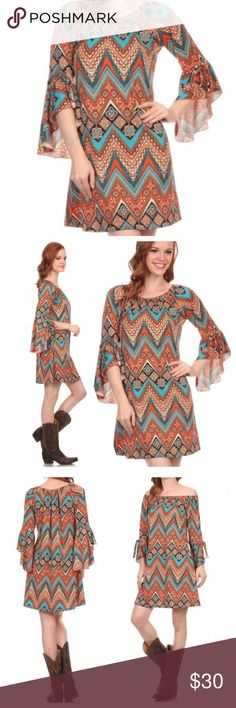 PRETTY AZTEC PRINT DRESS Beautiful shades of rust, orange, teal and black on this unique Aztec design. Flutter bell split sleeves that tie right above elbow! Cute! No wrinkle polyester/spandex blend. Measurements upon request. tla2 Dresses Mini