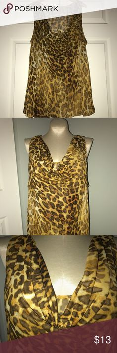 Lane Bryant Leopard Print Top Size 26/28 Lane Bryant Leopard Print Top Size 26/28. Gathered at Chest. Light Banding at the Bottom. Cute for Work or a Night Out. Lightweight Fabric. Lane Bryant Tops