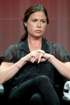 """Maura Tierney Photos Photos - Actress Maura Tierney speaks onstage at the """"The Affair"""" panel during the El Rey Network portion of the 2014 Summer Television Critics Association at The Beverly Hilton Hotel on July 18, 2014 in Beverly Hills, California. - Summer TCA Tour: Day 11"""