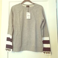 NWT Zara beaded sweatshirt. Size M Brand NWT Zara grey sweatshirt with stripes/beaded sleeves. Super cute for spring!! Nice light breathable material. Size medium fits like s/m. Total steal for what I paid! Zara Tops Blouses