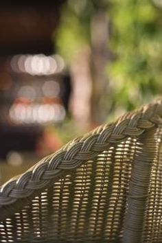 Wicker is a broad term for a type of woven furniture that's made from vines, plants or grasses. Rattan is a type of wicker furniture made from vines, and it's usually stained and sealed.