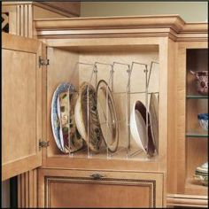 Rev-A-Shelf 18 in. Chrome Bakeware Organizer.  Also comes in 12 in. size.  I have pinned and like the idea of using tension rods, but this is a lot less expensive than buying multiple tension rods.  $9.99