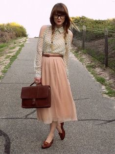 geek chic. - not big on the colour of the skirt, but love the style :)