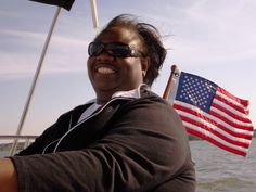 SOARING - Renee Williams of Northern Virginia was reluctant to take the wheel while sailing near Williamsburg. Within a few minutes, she adjusted to the heeling (tilting) effect of the boat in a stiff breeze of 15 mph. Her picture tells the rest of the story.