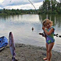 """A little girl shows off a """"pillowfish."""""""
