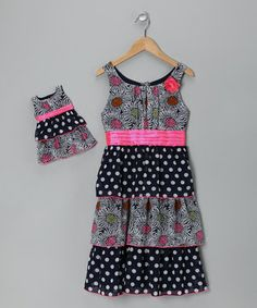 It'll be next to impossible to have anything less than the best day ever with this ruffle and polka dot-adorned dress to play in. A matching outfit for Dolly makes the fun even more infectious.