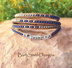 The Skinny Mini 5-Wrap in Cobalt n Silver This Skinny Mini is surrounded with four (4) more skinny wraps to keep her company! It is designed with Opaque Picasso Blue Super Duo beads, surrounded by rows of Frosted Cobalt and silver glass seed beads. It is accented with two (2)