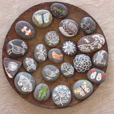 Story Stones - put a candle or vase of flowers in the middle for a nice center piece <3