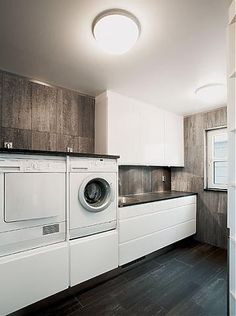 laundry room - L O V E the washer & dryer up on storage!!! I hate getting down on the floor to transfer clothes in & out.