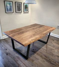 Ambrosia Maple live edge dining table by barnboardstore.com. This one was a medium coloured stain and was mounted on satin black trapezoid steel legs