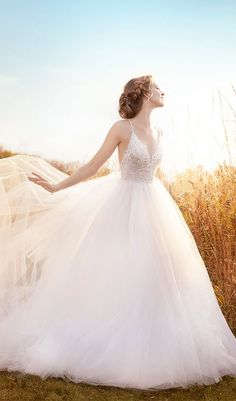 Try this ivory tulle wedding dress, sheer sequin embroidered bodice, V-neckline, natural waist, open back, sweep train from Jim Hjelm. Available at Schaffer's in Scottsdale, Arizona. Wedding Dress Info: Jim Hjelm – STYLE 8610.