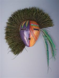 applying feathers to a gourd mask | Painted Gourds/Masks
