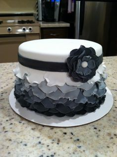 Beautiful layered petal (ombre) cake!!  If I ever learn how to use fondant, this is definitely on the top of my list!