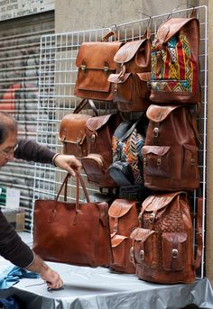 leather street vendor. want & Need this leather backpack so badly!!