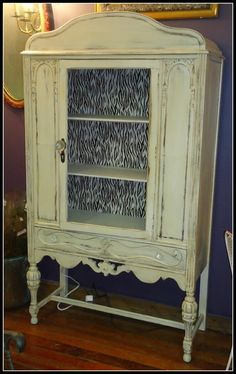 An Antique China Cabinet Is Updated With Some Fun Zebra Stripes.