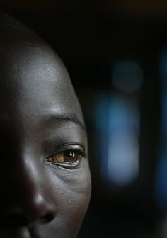 A boy sits in the dormitory of the UNICEF shelter. Democratic Republic Congo by Roger LeMoyne , UNICEF